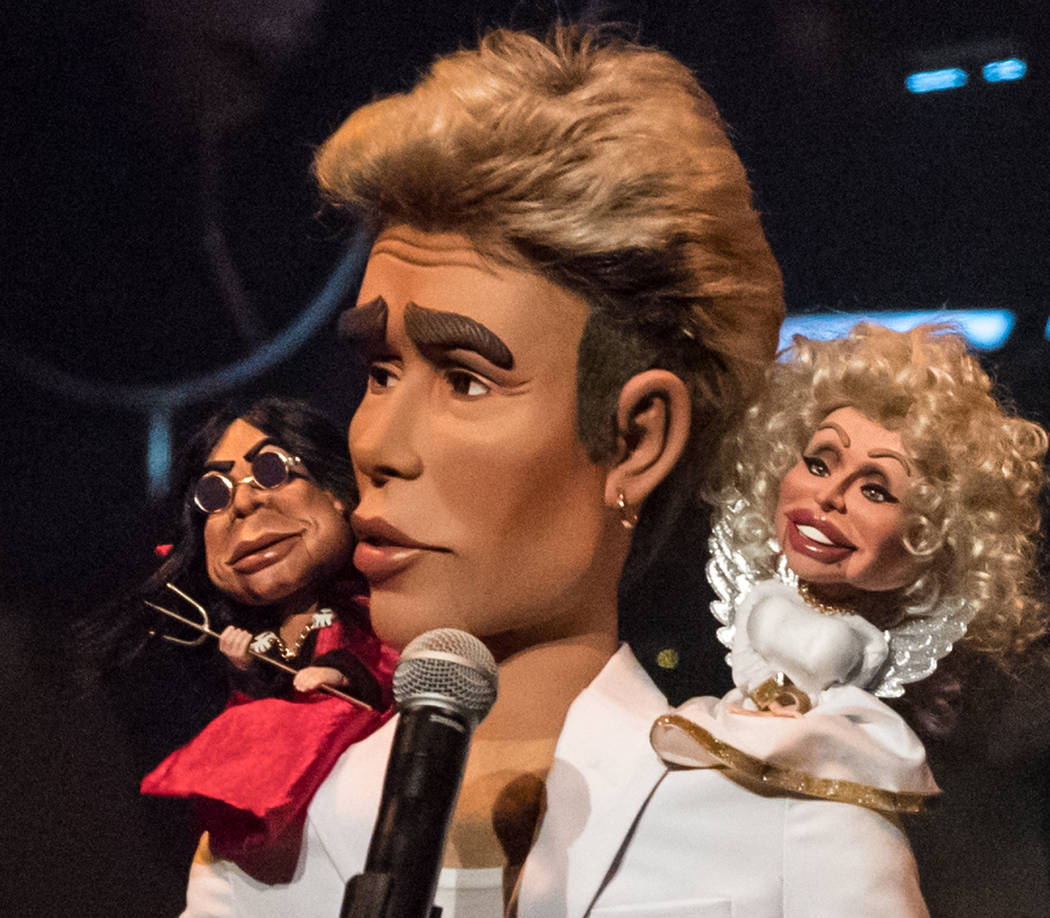 Justin Bieber, in puppet form, is shown in conference with devil Ozzy Osbourne and angel Dolly Parton at the Mirage on Friday, Nov. 23, 2018. (Tom Donoghue)