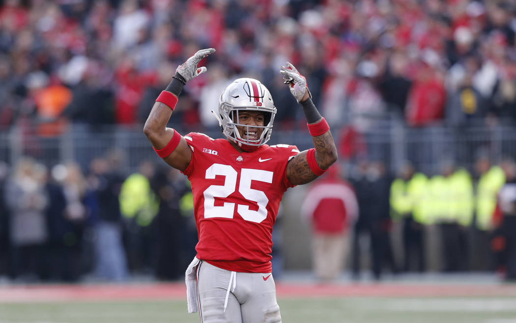 Ohio State defensive back Brendon White celebrates after making a tackle against Michigan during the second half of an NCAA college football game Saturday, Nov. 24, 2018, in Columbus, Ohio. Ohio S ...