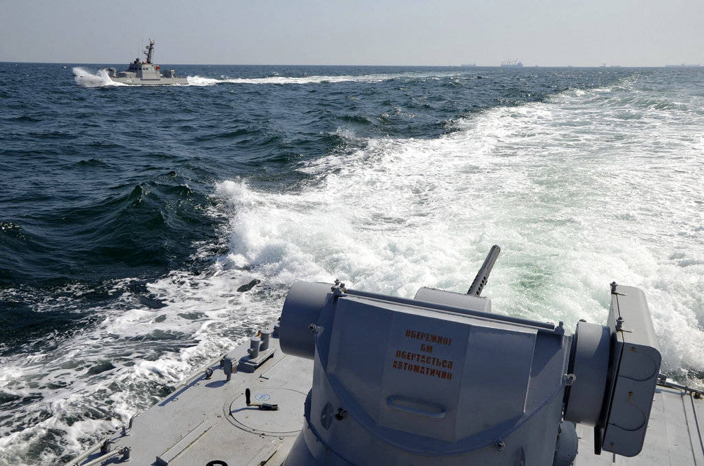 In this file photo taken and distributed by Ukrainian Navy Press Service on Sunday, Nov. 25, 2018, two Ukrainian forces navy ships are seen near Crimea. The Ukrainian navy says a Russian coast gua ...