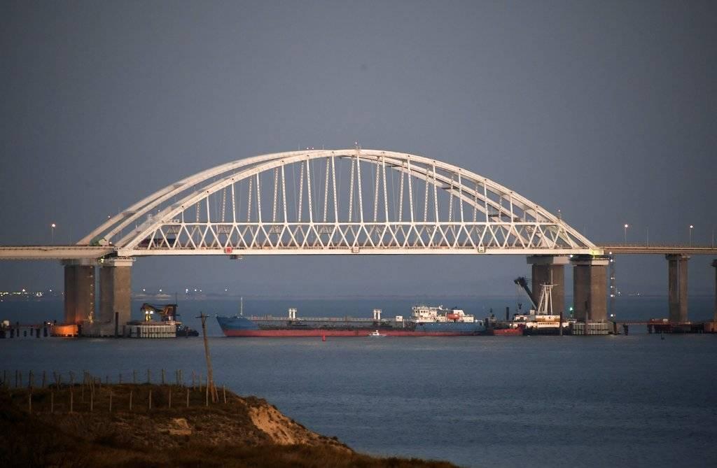 The Kerch bridge is seen blocked for ships entrance, near Kerch, Crimea, Sunday, Nov. 25, 2018. A Russian coast guard vessel rammed a Ukrainian navy tugboat near Crimea, damaging the ship's engin ...