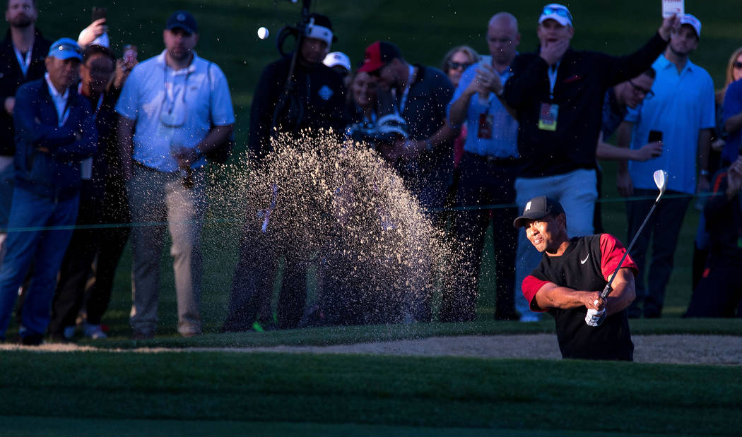 Tiger Woods hits from a bunker on the 16th during The Match at Shadow Creek Golf Course in North Las Vegas on Friday, Nov. 23, 2018. Richard Brian Las Vegas Review-Journal @vegasphotograph