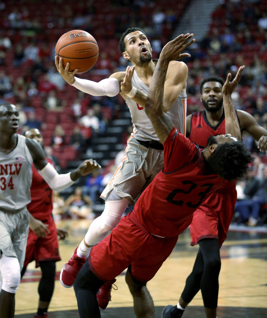 UNLV Rebels guard Noah Robotham (5) fouls Southern Utah Thunderbirds guard Cameron Oluyitan (23) in the second half of their NCAA basketball game at the Thomas & Mack Center in Las Vegas Frida ...