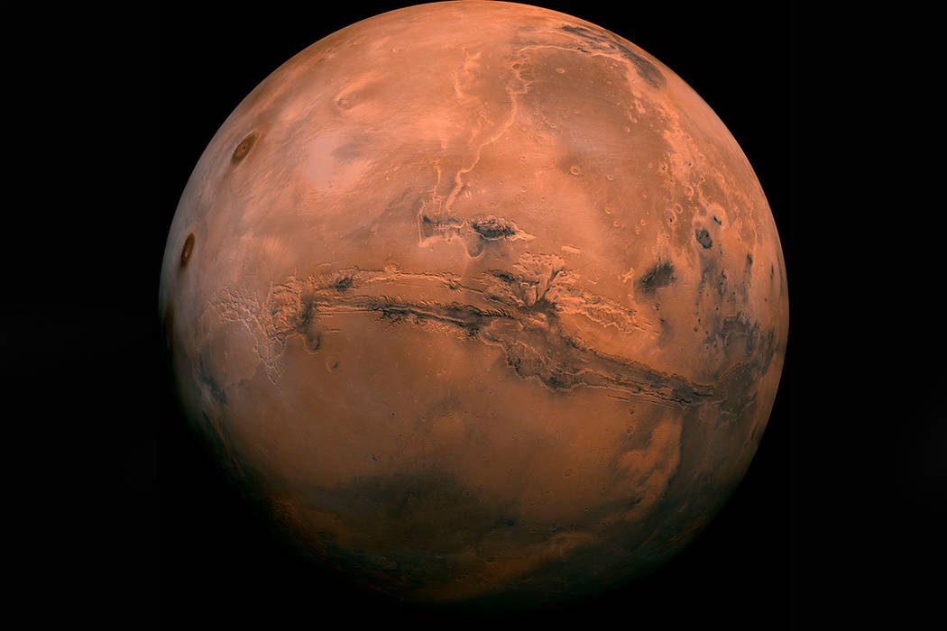 This composite photo was created from over 100 images of Mars taken by Viking Orbiters in the 1970s. (NASA via AP)