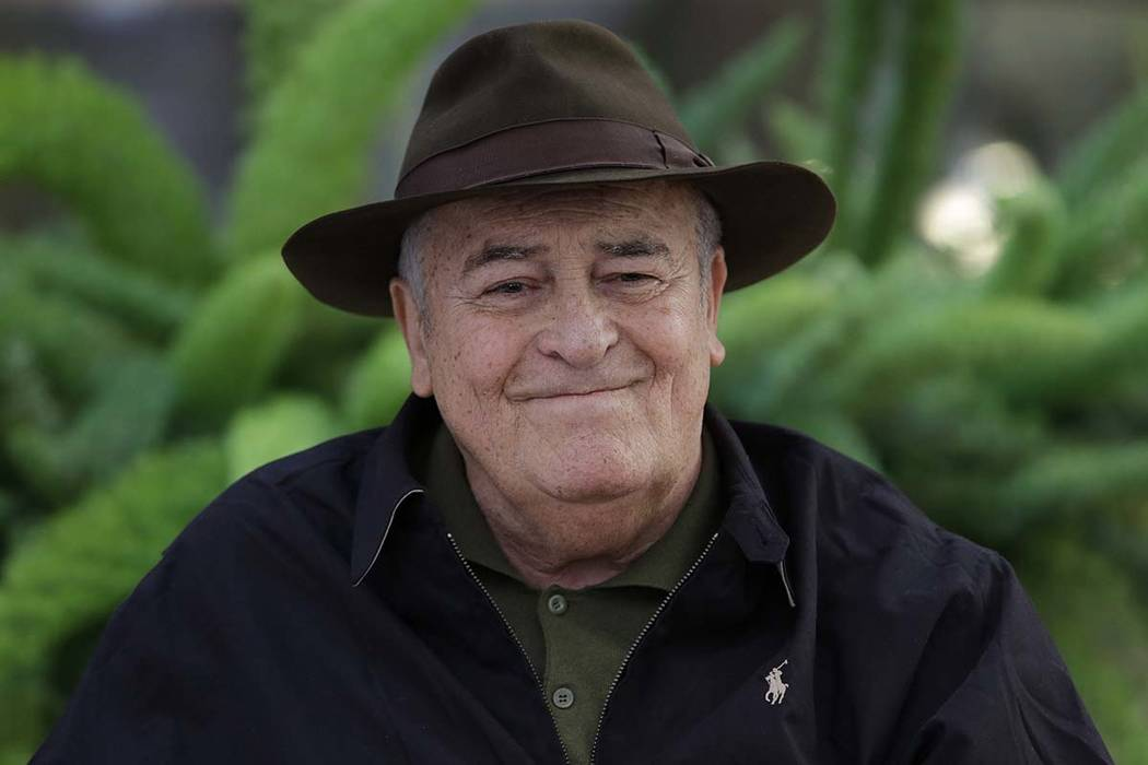 In this file photo taken on Oct. 18, 2012, Italian film director Bernardo Bertolucci poses for photographers during a photo call in Rome. (AP Photo/Andrew Medichini)