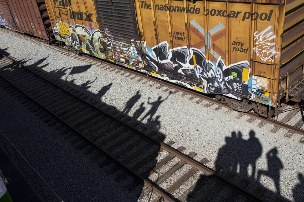 Shadows of migrants are cast on the railroad tracks at the Mexico-U.S. border in Tijuana, Mexico, Sunday, Nov. 25, 2018, as a group of migrants tries to reach the U.S. (Rodrigo Abd/AP)