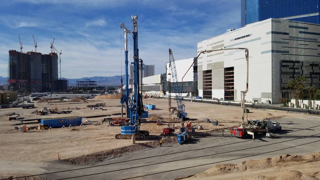 Workers drill holes 40 to 70 feet deep for piers for the Las Vegas Convention Center expansion project at Convention Center Drive and Paradise Road on Monday, Nov. 26, 2018. (Richard N. Velotta/La ...