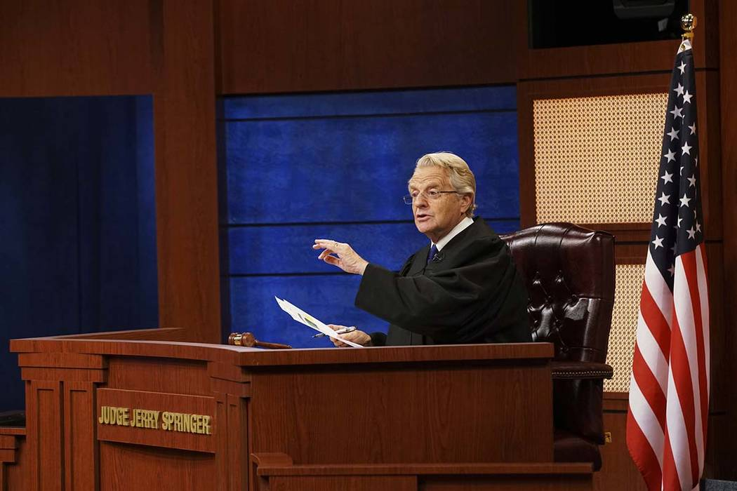 "An undated image provided by NBC shows Jerry Springer in a scene from ""Judge Jerry."" (Bennett Raglin/NBC via AP)"