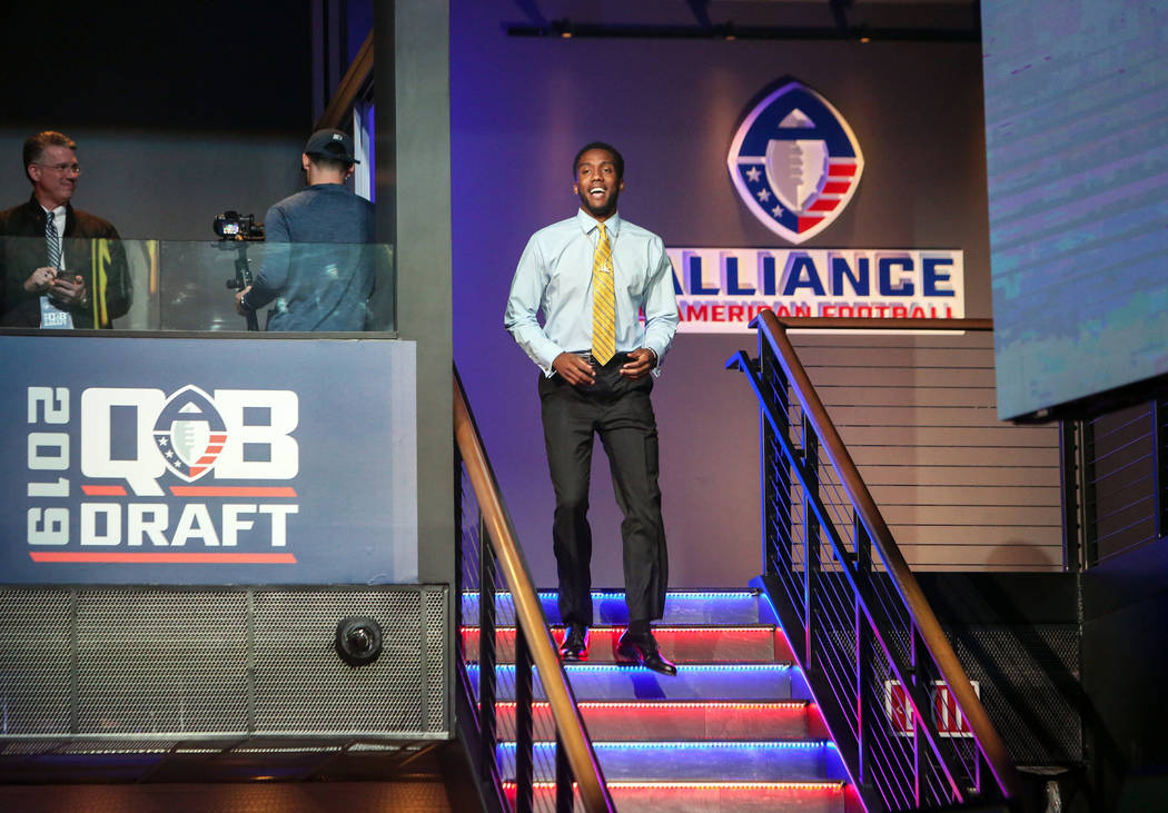 Josh Johnson walks down to the stage after becoming San Diego Fleet's first draft pick during the Alliance of America Football (AAF) Quarterback Draft at the Luxor in Las Vegas, Tuesday, Nov. 27, ...