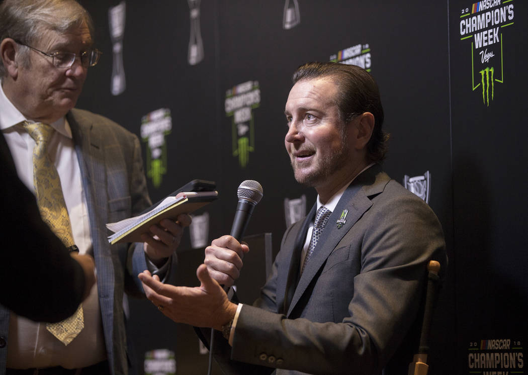 Driver Kurt Busch, right, speaks with the media after the NASCAR NMPA Myers Brothers Awards at Encore Theater on Wednesday, Nov. 28, 2018, at Wynn Las Vegas, in Las Vegas. Benjamin Hager Las Vegas ...