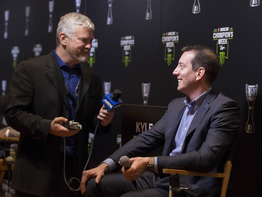 Driver Kyle Busch, right, speaks with the media after the NASCAR NMPA Myers Brothers Awards at Encore Theater on Wednesday, Nov. 28, 2018, at Wynn Las Vegas, in Las Vegas. Benjamin Hager Las Vegas ...