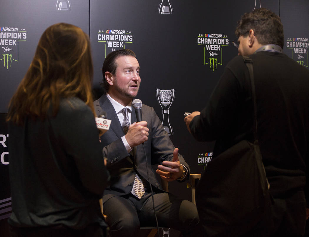 Driver Kurt Busch, middle, speaks with the media after the NASCAR NMPA Myers Brothers Awards at Encore Theater on Wednesday, Nov. 28, 2018, at Wynn Las Vegas, in Las Vegas. Benjamin Hager Las Vega ...
