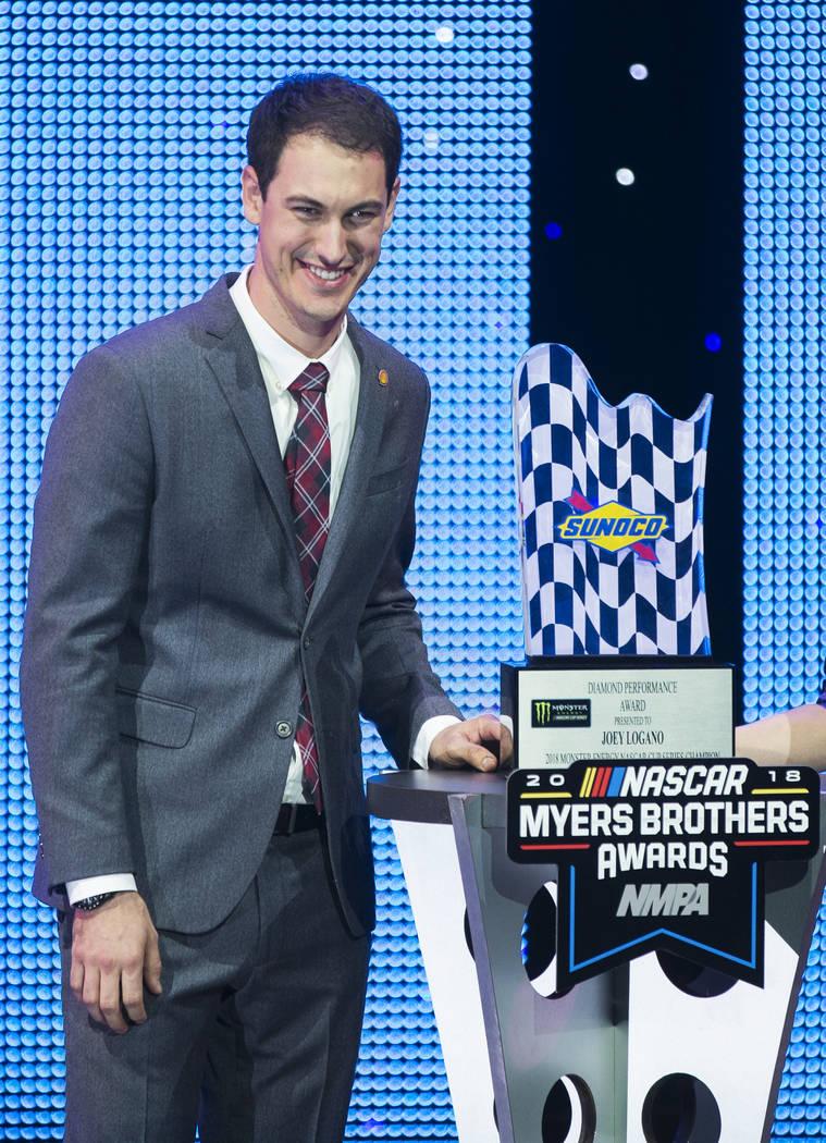 Joey Logano takes photos with the Diamond Performance Award during the NASCAR NMPA Myers Brothers Awards at Encore Theater on Wednesday, Nov. 28, 2018, at Wynn Las Vegas, in Las Vegas. Benjamin Ha ...