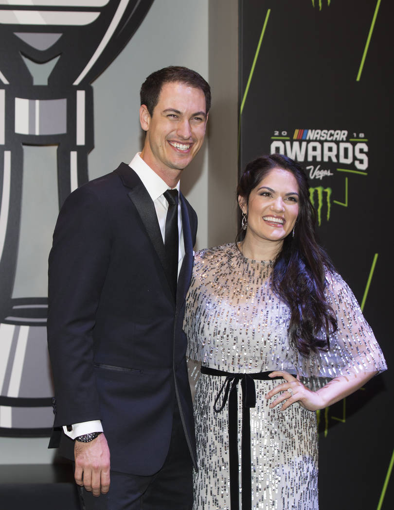 Joey Logano, the 2018 Monster Energy NASCAR Cup Series Champion, and wife Brittany take photos during the Fan Red Carpet on Thursday, Nov. 29, 2018, at Wynn Las Vegas, in Las Vegas. Benjamin Hager ...