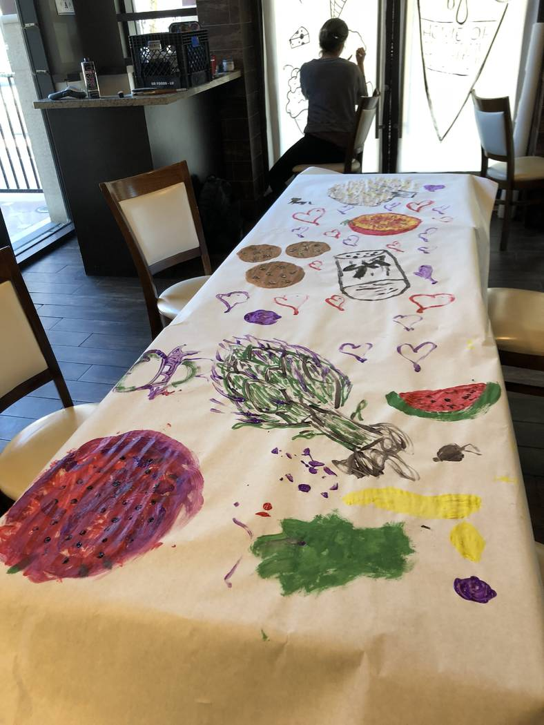 Esther's Kitchen hosted a paint party on Saturday, Nov. 24, 2018 at Tivoli Village to decorate the construction windows of a new project James Trees' project called Ada's. (Al Mancini/Las Vega ...