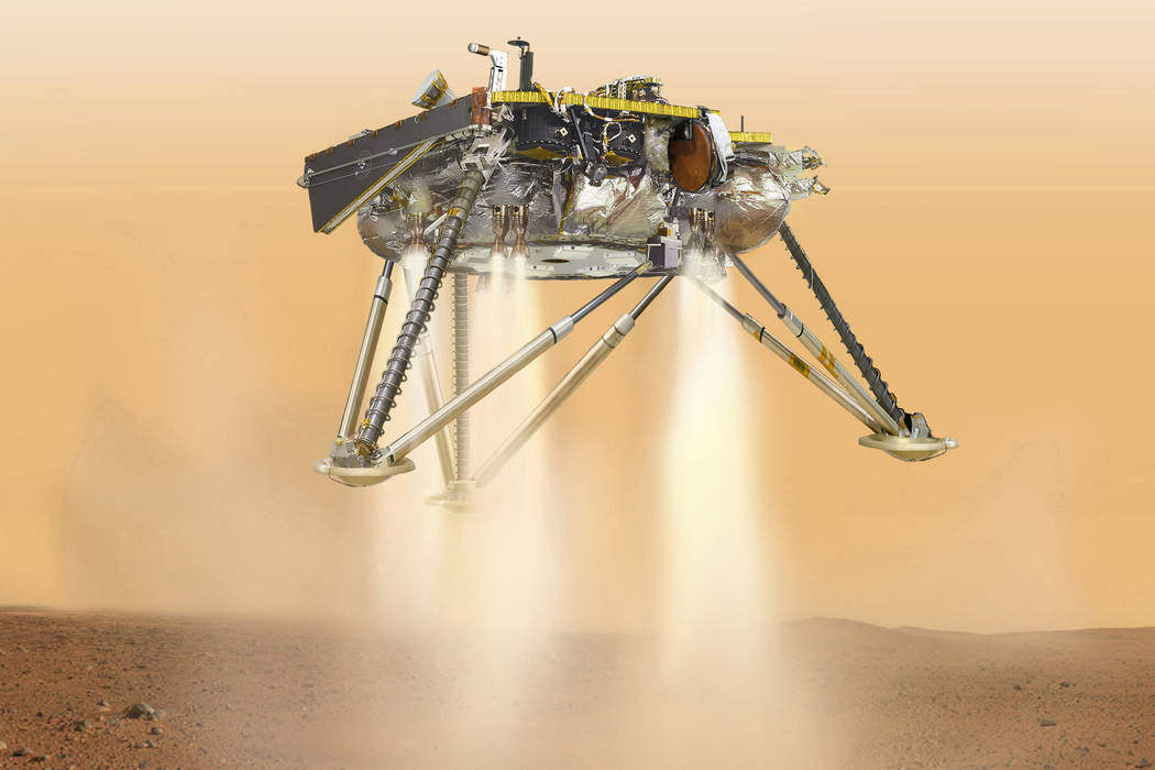This illustration made available by NASA in October 2016 shows an illustration of NASA's InSight lander about to land on the surface of Mars. NASA's InSight spacecraft will enter the Martian atmos ...
