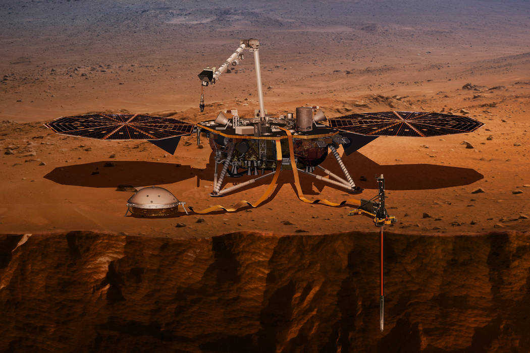 This illustration made available by NASA in 2018 shows the InSight lander drilling into the surface of Mars. InSight, short for Interior Exploration using Seismic Investigations, Geodesy and Heat ...