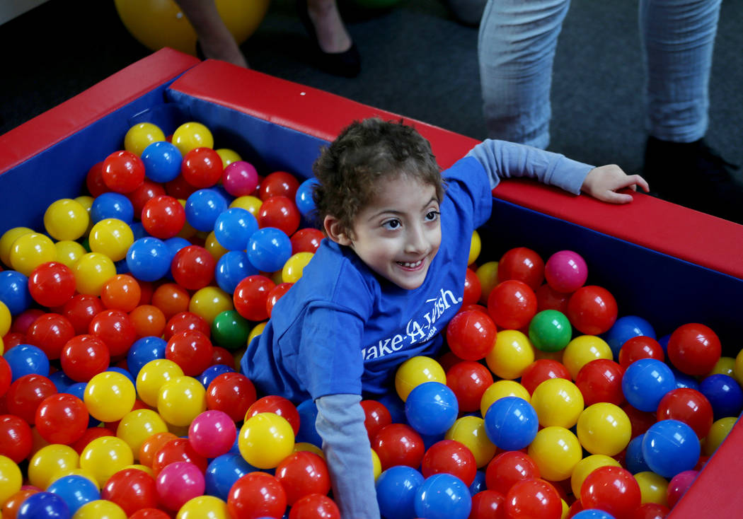 Sultan Bouras Souissi, 7, plays in the ball pit in his new playhouse in North Las Vegas on Monday, Nov. 26, 2018. Sultan has spina bifida, a disease that affects his immune system and makes it har ...