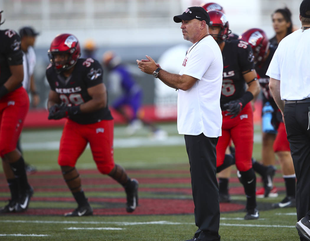 UNLV Rebels head coach Tony Sanchez watches as his players warm up before the start of a football game against Prairie View A&M Panthers at Sam Boyd Stadium in Las Vegas on Saturday, Sept. 15 ...