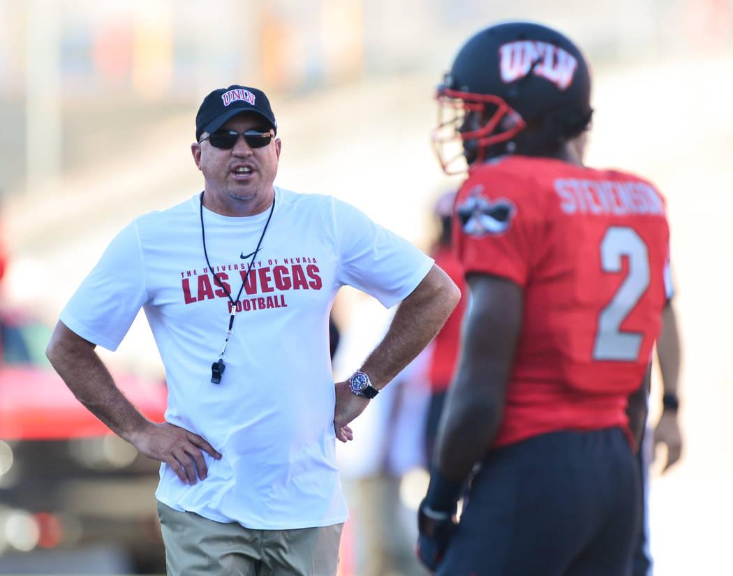 UNLV Rebels head coach Tony Sanchez talks to UNLV Rebels wide receiver Mekhi Stevenson (2) before the Rebels game against the UTEP Miners at Sam Boyd Stadium in Las Vegas on Saturday, Sept. 8, 201 ...