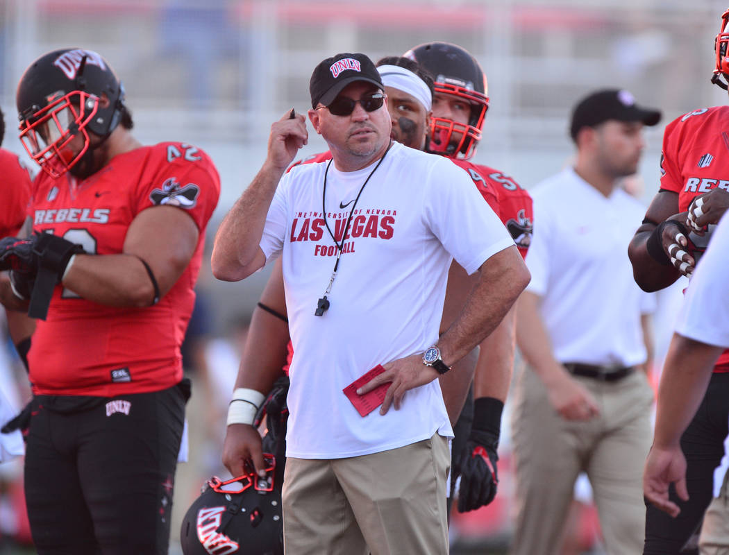 UNLV Rebels head coach Tony Sanchez watches his team warm up before a game against the UTEP Miners at Sam Boyd Stadium in Las Vegas on Saturday, Sept. 8, 2018. Brett Le Blanc Las Vegas Review-Journal