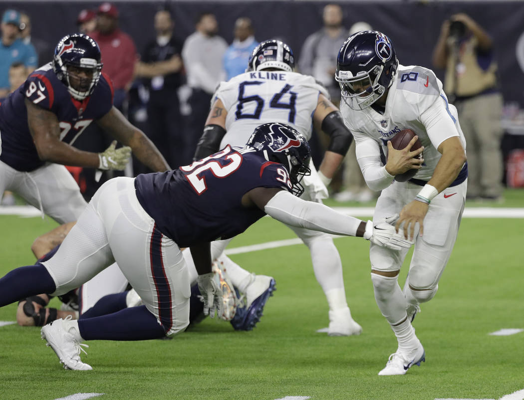55566c89 Tennessee Titans quarterback Marcus Mariota (8) is pressured by Houston  Texans nose tackle Brandon