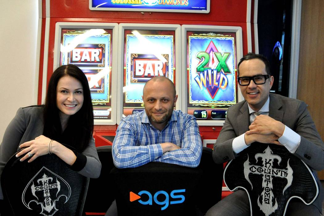 Key members of the executive team at AGS are, from left, Julia Boguslawski, chief marketing officer; David Lopez, chief executive officer, and Kimo Akiona, chief financial officer. (Joe Coomber, s ...