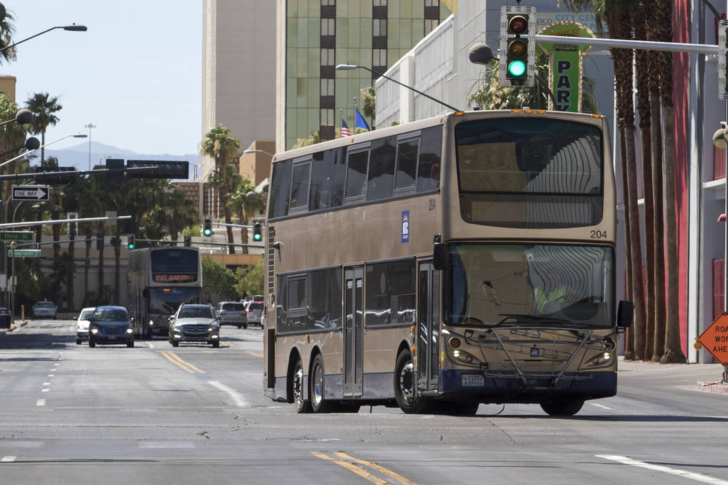 An RTC bus turns onto North Las Vegas Boulevard from East Carson Avenue in downtown Las Vegas on Friday, June 9, 2017. (Richard Brian/Las Vegas Review-Journal) @vegasphotograph