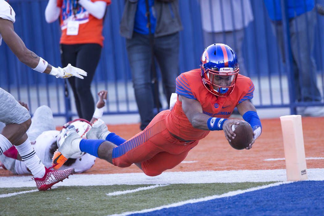 Bishop Gorman's Micah Bowens (1) reaches for the end zone after stepping out of bounds against Liberty during the second half of the NIAA 4A Desert Region championship game at Bishop Gorman High S ...