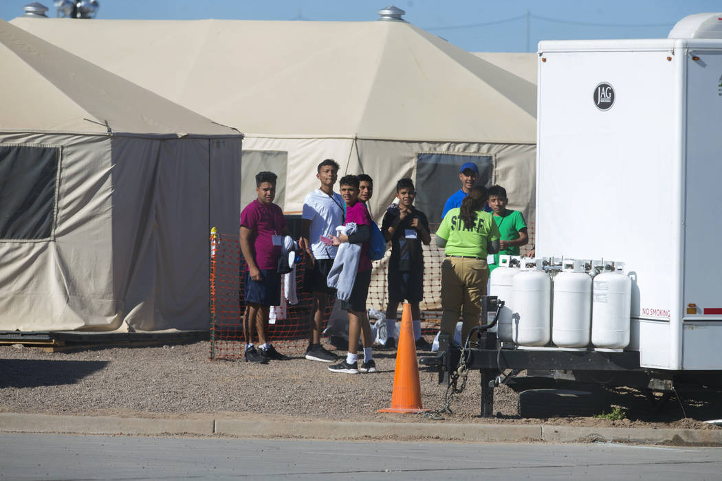 Migrant teens held inside the Tornillo detention camp look at protestors waving at them outside the fences surrounding the facility in Tornillo, Texas, Nov. 15, 2018. Less than six months after op ...