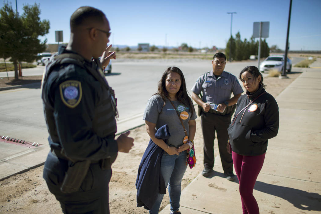 Dalila Reynoso-Gonzalez, center left, a program director for the Methodist immigration advocacy group Justice for our Neighbors of East Texas, and another protestor talk with a Department of Homel ...
