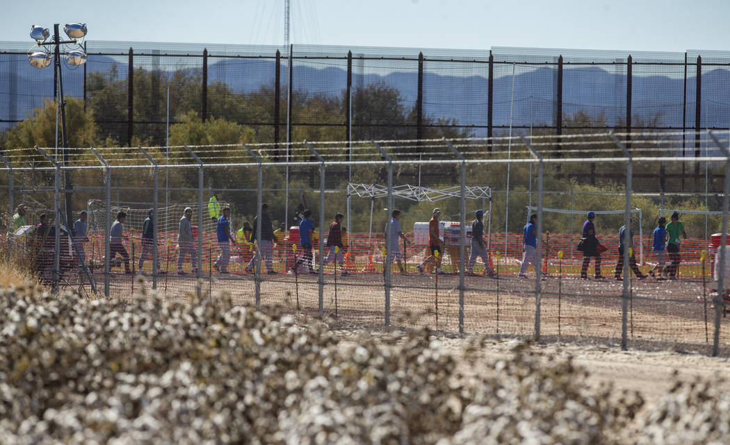 Migrant teens are led in a line inside the Tornillo detention camp holding more than 2,300 migrant teens in Tornillo, Texas, Nov. 15, 2018. The Trump administration announced in June 2018 that it ...