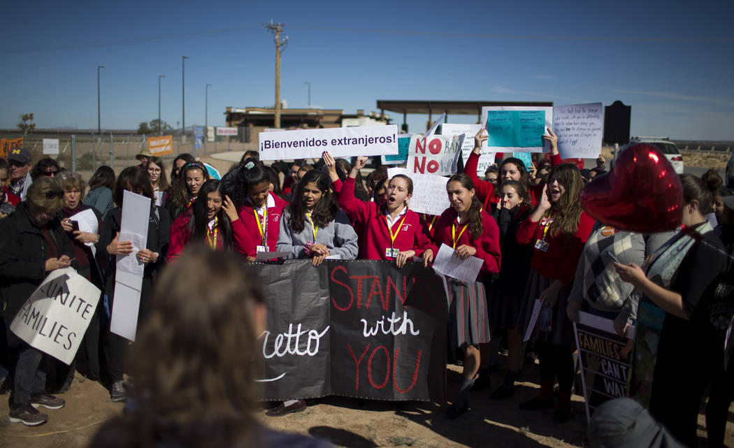 Students from a local Catholic school protest outside the Tornillo detention camp holding more than 2,300 migrant teens in Tornillo, Texas, Nov. 15, 2018. (Ivan Pierre Aguirre via AP)