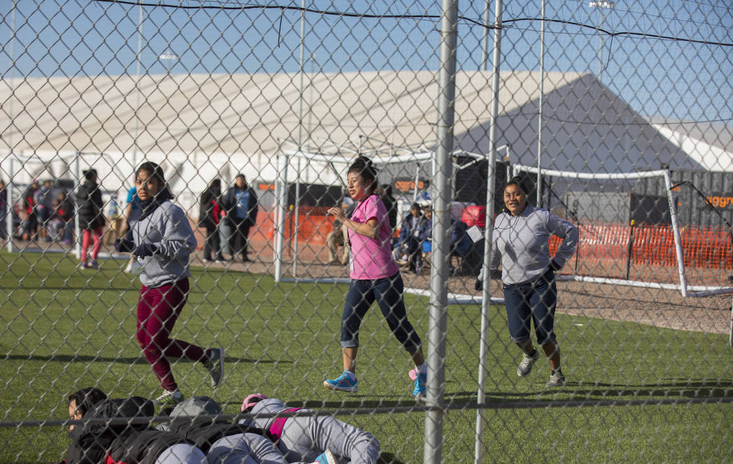 Migrant teens held inside the Tornillo detention camp run at the facility in Tornillo, Texas, Nov. 25, 2018. Less than six months after opening, the facility has expanded into a detention camp hol ...