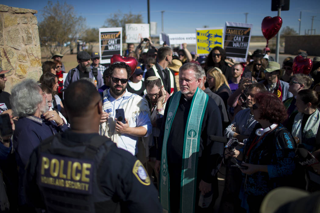 Rabbis and other faith leaders talk with a Department of Homeland Security official outside the Tornillo detention camp holding more than 2,300 migrant teens in Tornillo, Texas, Nov. 15, 2018. (Iv ...