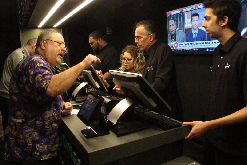 A gambler placing a sports bet at Resorts Casino in Atlantic City, N.J. on Nov. 20, 2018. Numerous U.S. states are considering joining the seven that currently offer legal sports betting. (AP Phot ...