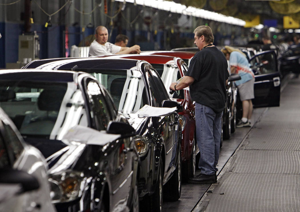 In this file photo, workers at General Motors' Lordstown Assembly plant in Lordstown, Ohio, put the final touches on Chevy Cobalts. One of the last industrial anchors in what was once the heart of ...