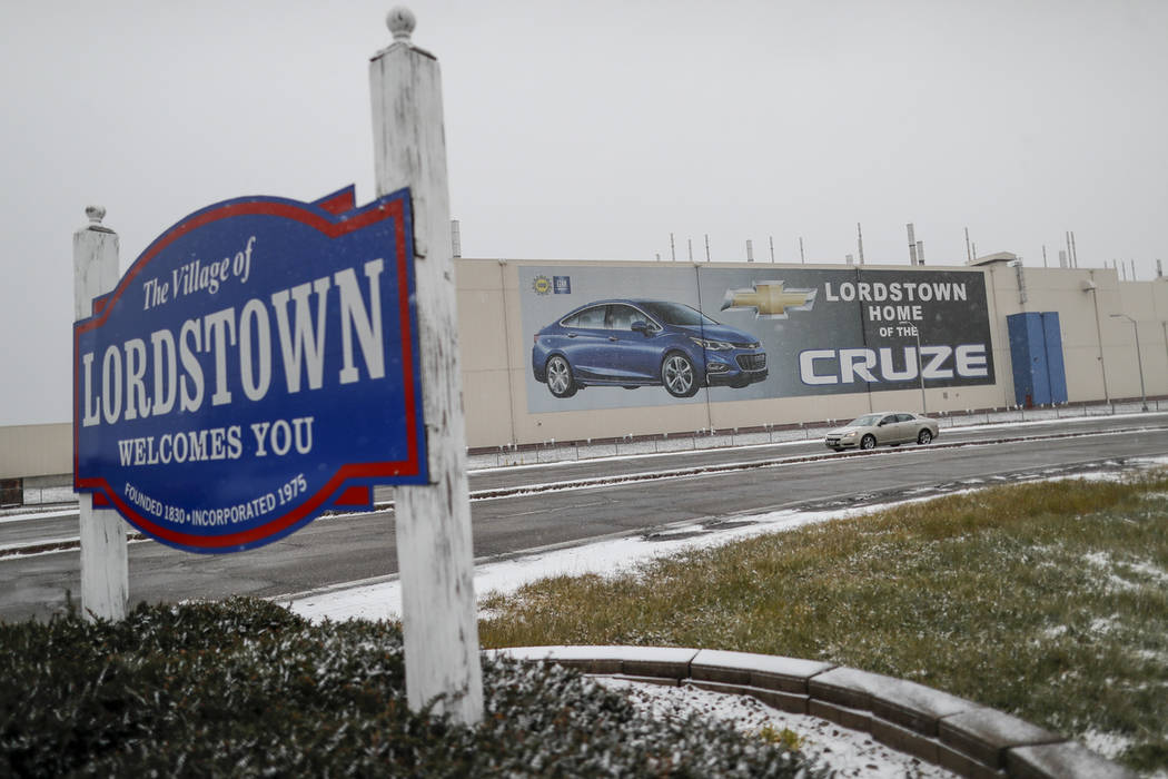 A banner depicting the Chevrolet Cruze model vehicle is displayed at the General Motors' Lordstown plant, Tuesday, Nov. 27, 2018, in Lordstown, Ohio. Even though unemployment is low, the economy i ...