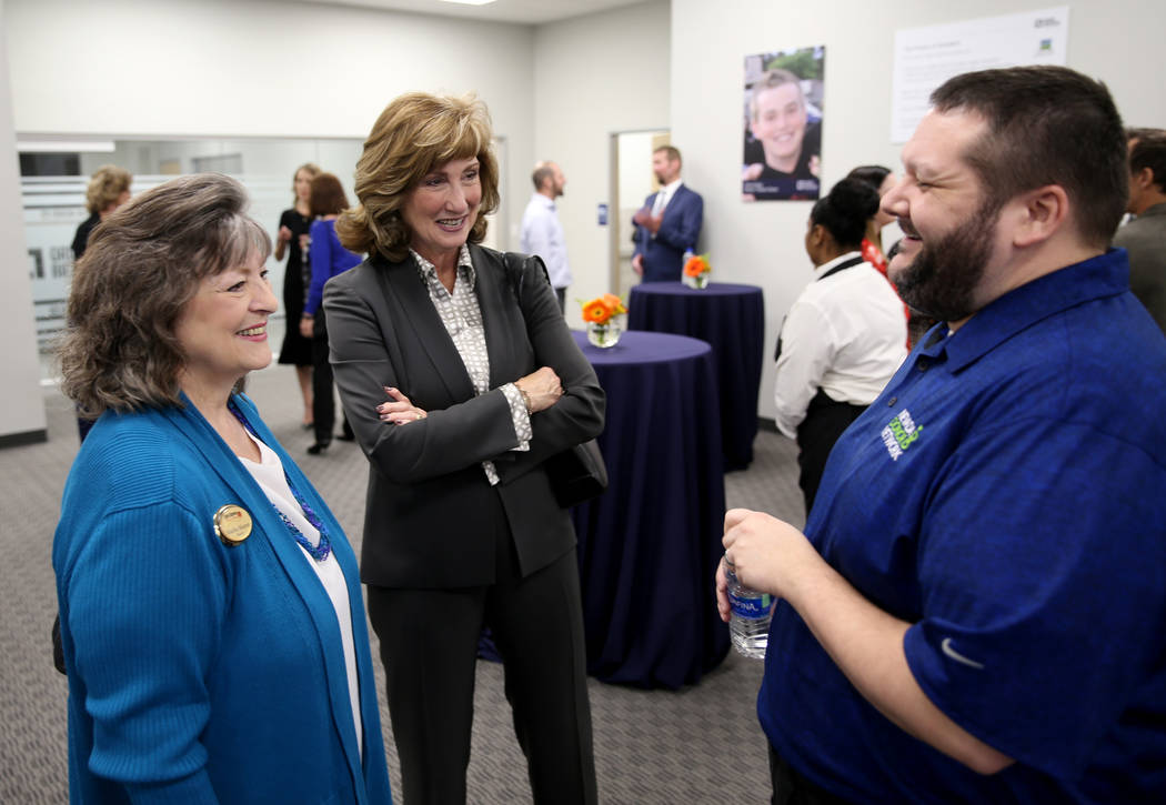 Martha Marton of EasyStreet Realty, left, Victoria VanMeetren with College of Medicine at Roseman University of Health Sciences and Kevin Burns of Nevada Donor Network mingle during an open house ...