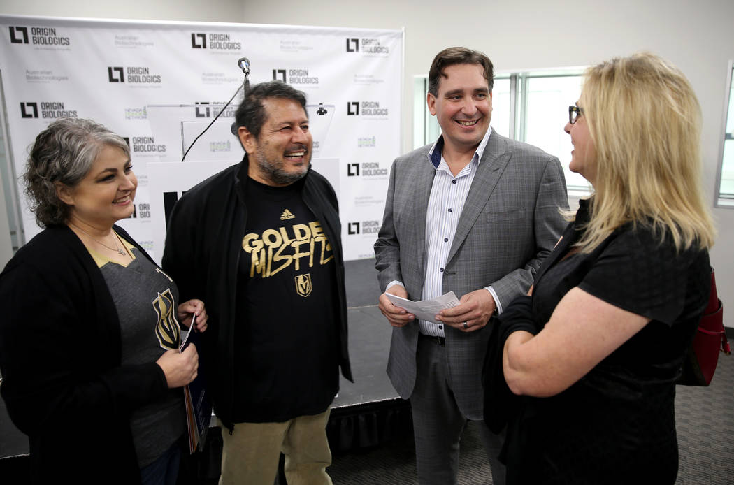 Origin Biologics CEO Chad Ronholdt, second from right, mingles with his wife Laurie, right, Dante Amato, the architect of the building, and Amato's wife Natasha during an open house for Origin Bio ...