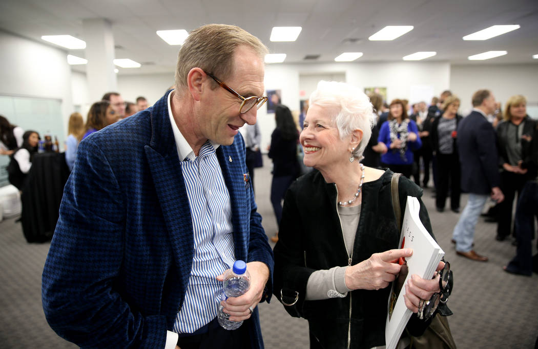Mike Ravenhill of The David Foster Foundation and Marsala Rypka of The Class Project mingle during an open house for Origin Biologics at 6635 South Eastern Ave. in Las Vegas, Friday, Nov. 16, 2018 ...