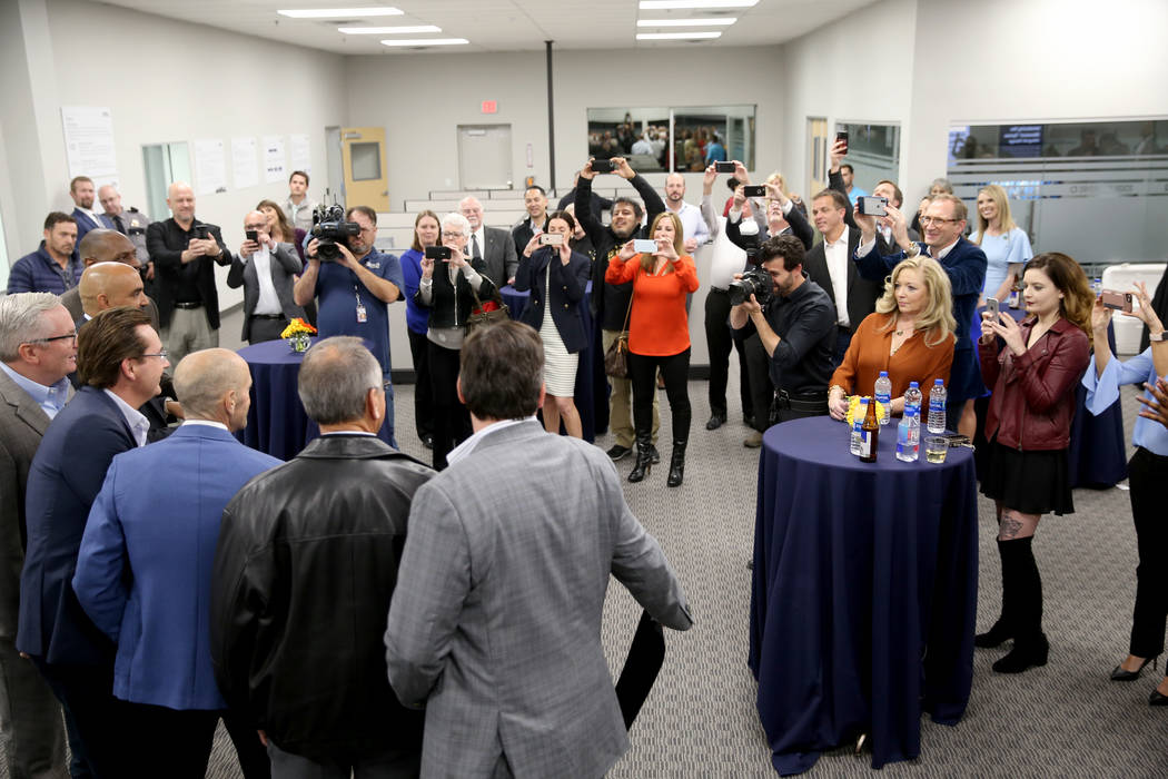Guests watch as a ribbon is cut during an open house for Origin Biologics at 6635 South Eastern Ave. in Las Vegas, Friday, Nov. 16, 2018. K.M. Cannon Las Vegas Review-Journal @KMCannonPhoto