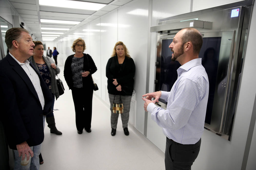 Dean Nistal of Step Change Business Consulting, right, gives a tour during an open house for Origin Biologics at 6635 South Eastern Ave. in Las Vegas, Friday, Nov. 16, 2018. K.M. Cannon Las Vegas ...