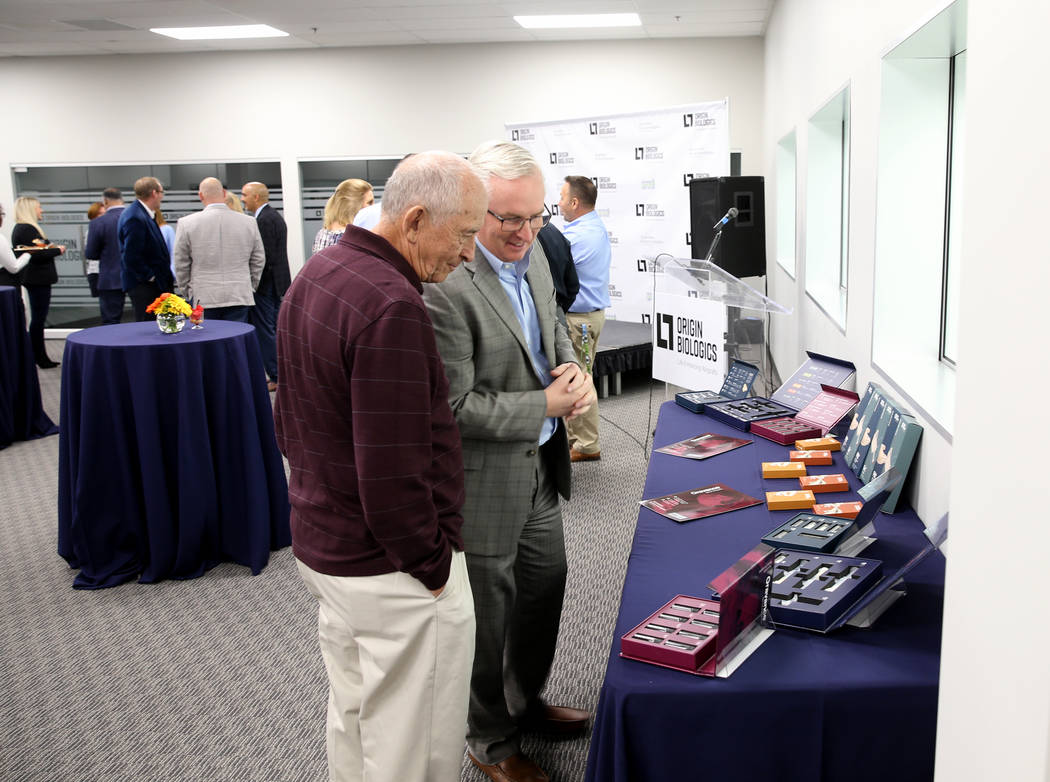 Cam Walker, a board member with Origin Biologics, right, and his father Bud tour during an open house for Origin Biologics at 6635 South Eastern Ave. in Las Vegas, Friday, Nov. 16, 2018. K.M. Cann ...