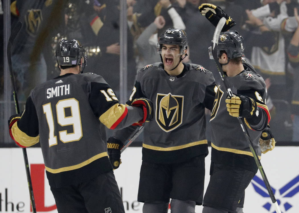 Vegas Golden Knights right wing Reilly Smith (19) and defenseman Colin Miller, right, celebrate after left wing Max Pacioretty, center, scored against the San Jose Sharks during the first period o ...