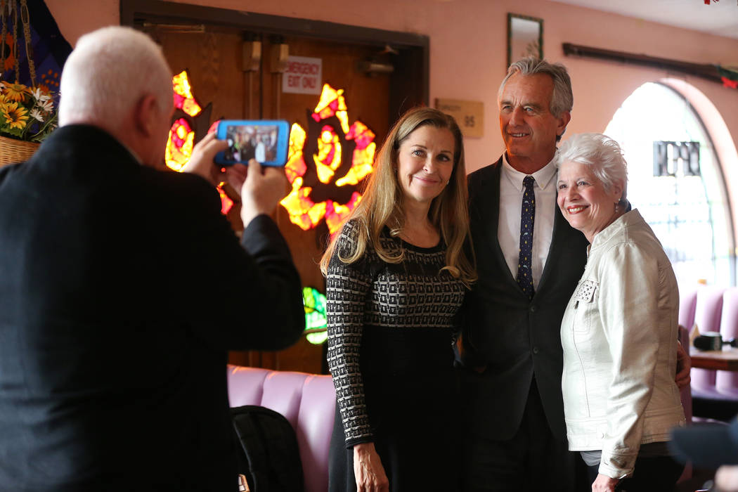 Bobby Kennedy Jr., center, Waterkeeper Alliance president, takes a photo with Pauline van Bette, left, and Marsala Rypka, during a kick-off event for the Las Vegas affiliate chapter of the Colora ...