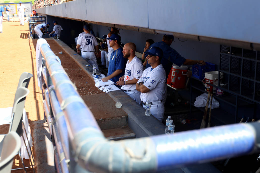 Las Vegas players and coaches in the dugout during the final 51s game ever at Cashman Field in Las Vegas Monday, Sept. 3, 2018. Las Vegas beat Sacramento 4-3. The team will move to a new stadium i ...