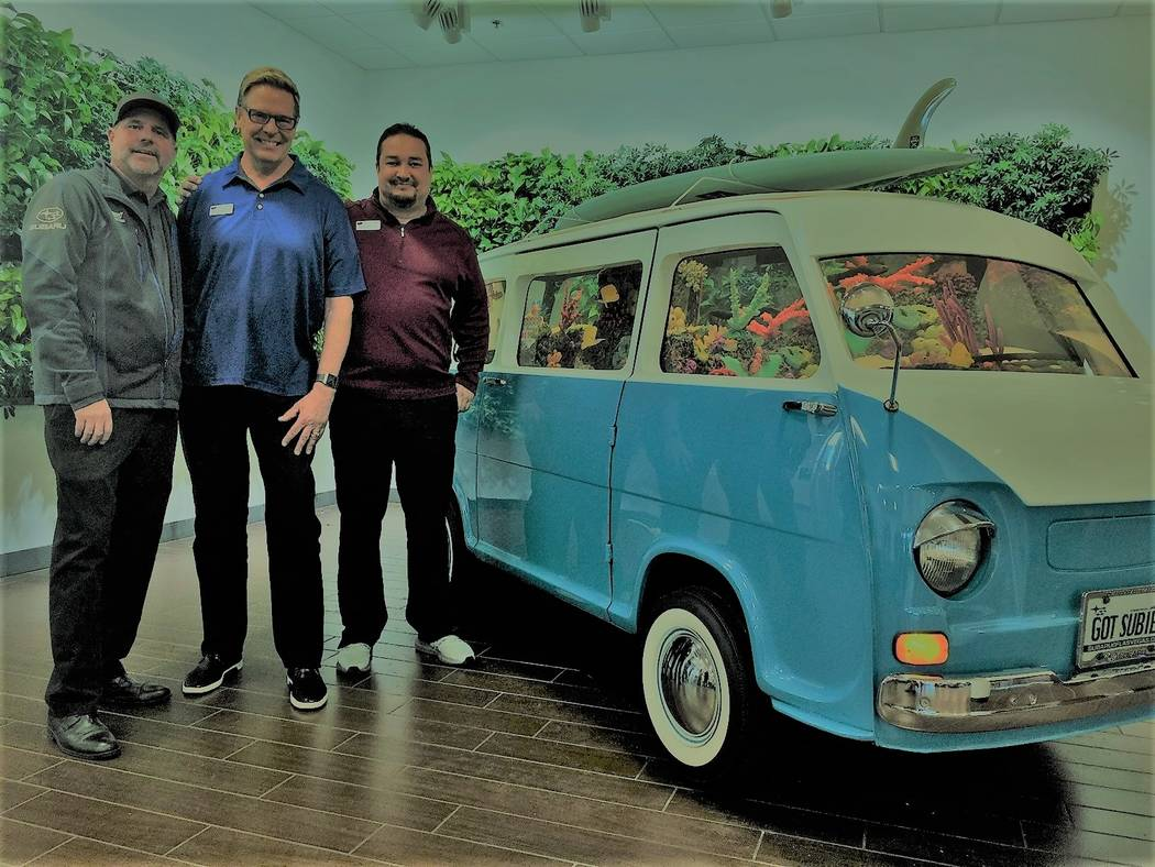 Subaru of Las Vegas recently showcased a unique aquarium in the dealership showroom at 6455 Roy Horn Way. From left, Parts Manager Kelly Brian, General Manager Burton Hughes and Parts and Service ...