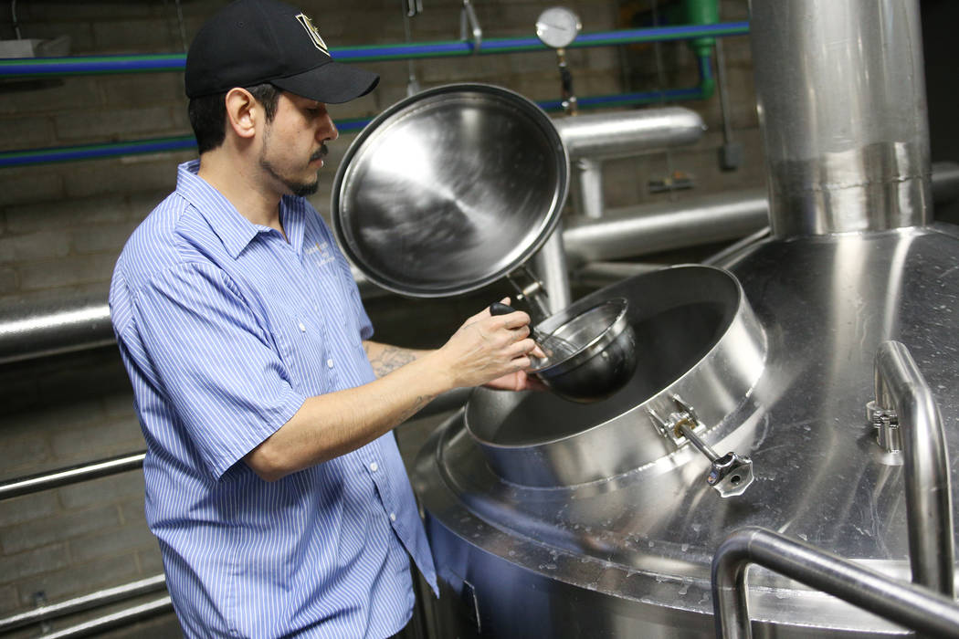 Lead Brewer Marcos Lopez adds yeast nutrients to a tank of Resilience IPA at Tenaya Creek Brewery in Las Vegas on Tuesday, Nov. 27, 2018. Sierra Nevada has asked breweries to join in making the be ...