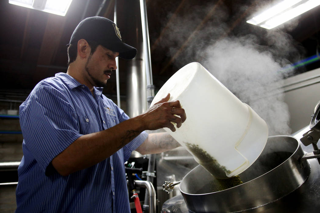 Lead Brewer Marcos Lopez adds hops to a tank for Resilience IPA at Tenaya Creek Brewery in Las Vegas on Tuesday, Nov. 27, 2018. Sierra Nevada has asked breweries to join in making the beer, and al ...