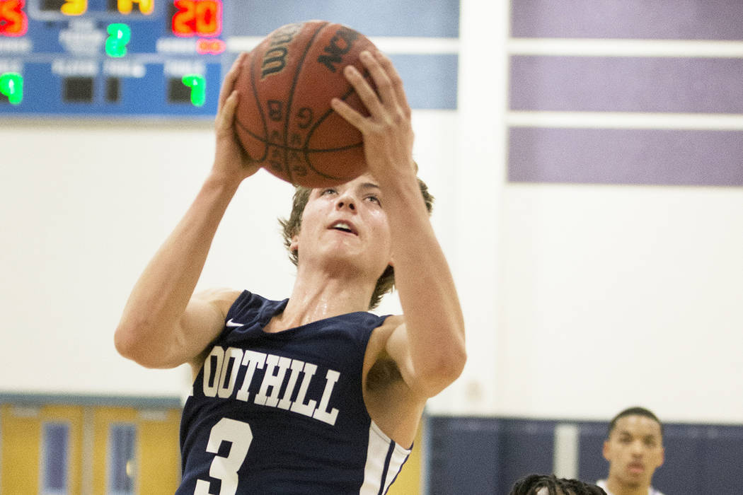 Foothill senior Collin Russell (3) slices to the rim past Canyon Springs junior Tommie Anderson (5) in the second quarter on Tuesday, Nov. 27, 2018, at Canyon Springs High School, in North Las Veg ...